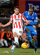 Joe hanks makes a pass during the Sky Bet League 2 match between Cheltenham Town and Portsmouth at Whaddon Road, Cheltenham, England on 20 December 2014. Photo by Alan Franklin.