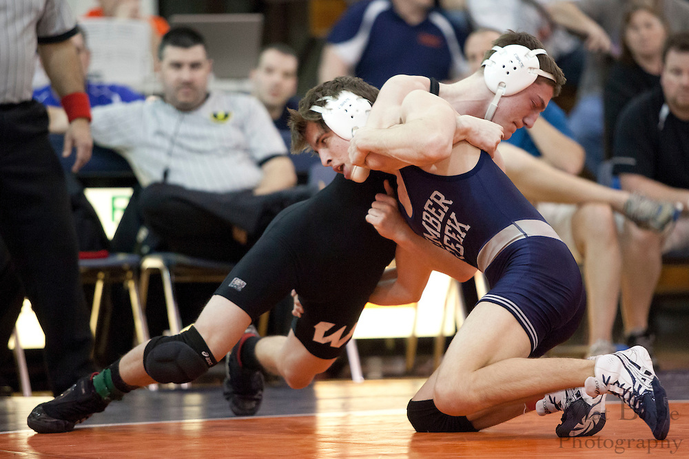 Robert McNeill of Winslow High School defeats. Brandon Virgilio of  Timber Creek High School, by decision 7-3, in the District 30 Wrestling 170lb weight class final at Overbrook High School on February 18, 2012. (photo / Mat Boyle)