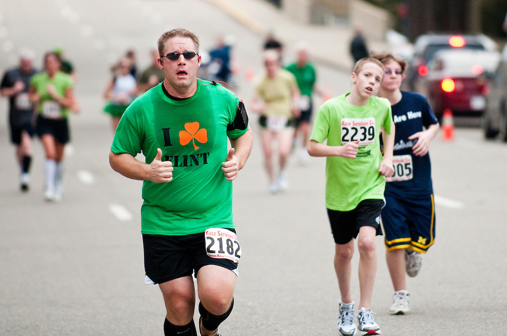 Matt Dixon   The Flint Journal..Runners compete in the 30th Pot O'Gold Road Race in downtown flint on St. Patrick's Day.