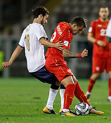 October 6, 2017 - Turin, Italy - Marco Parolo (L) of Italy national team and Aleksandar Trajkovski of FYR Macedonia national team vie for the ball during the 2018 FIFA World Cup Russia qualifier Group G football match between Italy and FYR Macedonia at Stadio Olimpico on October 6, 2017 in Turin, Italy. (Credit Image: © Mike Kireev/NurPhoto via ZUMA Press)