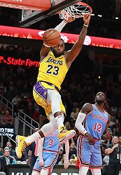 February 12, 2019 - Atlanta, GA, USA - Los Angeles Lakers' LeBron James dunks for two over Atlanta Hawks Taurean Prince during the second half on Tuesday, Feb. 12, 2019 in Atlanta, Ga. (Credit Image: © Curtis Compton/Atlanta Journal-Constitution/TNS via ZUMA Wire)