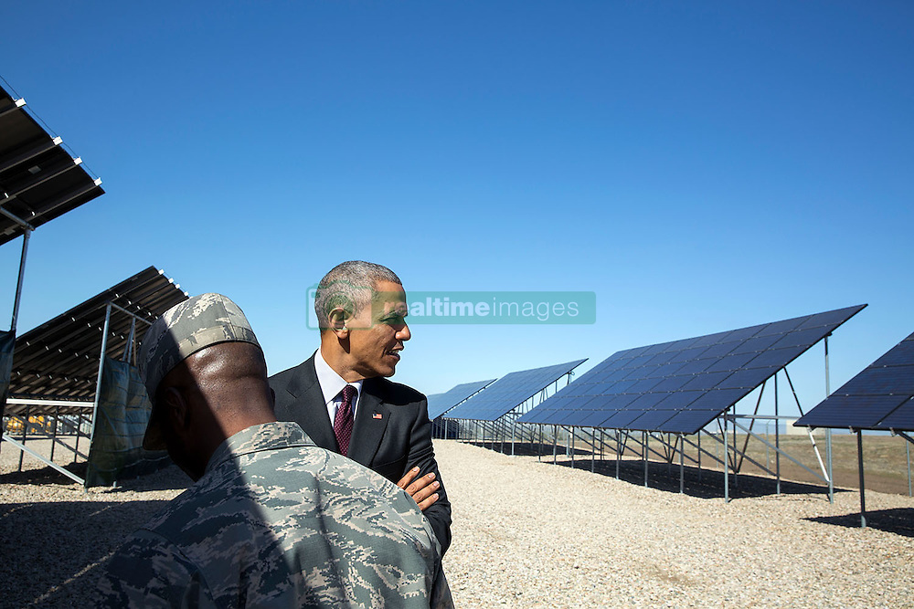President Barack Obama takes a tour of solar panels with Col. Ronald E. Jolly, Commander, at Hill Air Force Base, Utah, April 3, 2015. (Official White House Photo by Pete Souza)<br /> <br /> This official White House photograph is being made available only for publication by news organizations and/or for personal use printing by the subject(s) of the photograph. The photograph may not be manipulated in any way and may not be used in commercial or political materials, advertisements, emails, products, promotions that in any way suggests approval or endorsement of the President, the First Family, or the White House.
