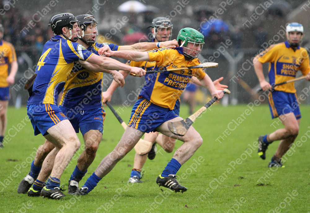 10/11/13  Sixmilebridge's Pa Sheehan breaks away from Newmarket players during the Senior Hurling County Final in Cusack Park. Pic Tony Grehan / Press 22