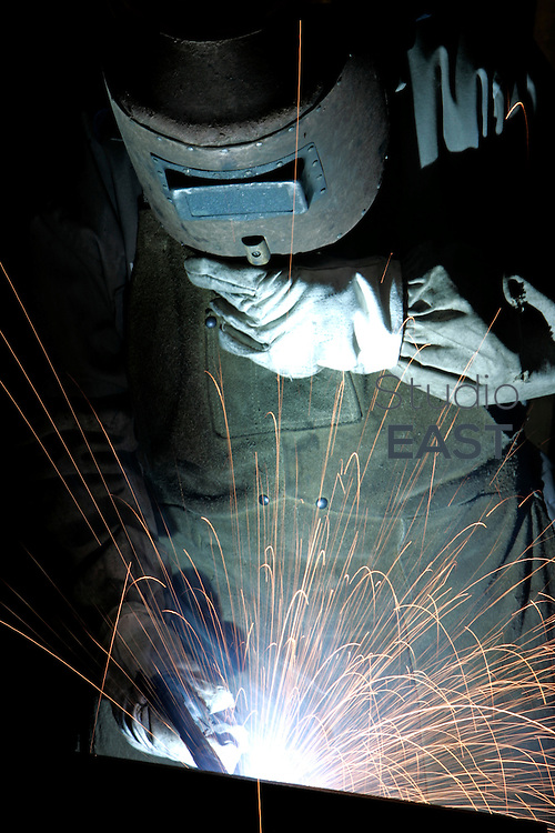 A worker welds in a factory, in Baoshan, near Shanghai, China, on January 13, 2009. Baosteel, China's biggest steel producer, is to take over Ningbo Iron and Steel Group and Baotou Iron and Steel Group. The Chinese government is encouraging mergers in order to restructure the steel industry, according to the steel industry stimulus plan approved by the State Council in January. Photo by Servais Mont/Pictobank