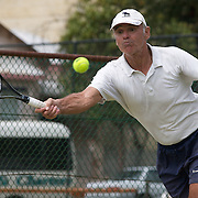 Sverre Worren, Norway, in action against Bob Howes, Australia,  during the Jack Crawford Cup match during the 2009 ITF Super-Seniors World Team and Individual Championships at Perth, Western Australia, between 2-15th November, 2009.