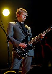 Robert Byron Hardy of Franz Ferdinand, on stage at Prince's Street Gardens, Edinburgh, Scotland, August 2005..©Pic : Michael Schofield...