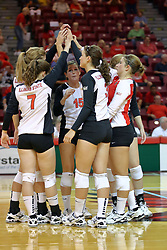 30 August 2011: Redbird Volleyball team huddle (Kristin Stauter in center) during an NCAA volleyball match between the Cougars of Southern Illinois Edwardsville and the Illinois State Redbirds at Redbird Arena in Normal Illinois.