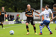 Newport County's David Pipe looks to go past Bury's Jordan Mustoe (r). Skybet Football League two match, Bury v Newport county at Gigg Lane in Bury on Saturday 5th Oct 2013. pic by David Richards, Andrew Orchard sports photography,