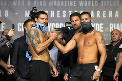 Oleksandr Usyk (left) and Tony Bellew during the weigh in at Manchester Central.