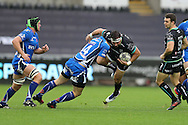 Scott Baldwin of the Ospreys is stopped in his tracks by a tackle from Pat Howard of the Newport Gwent Dragons.  Guinness Pro12 rugby match, Ospreys v Newport Gwent Dragons at the Liberty Stadium in Swansea, South Wales on 29th October 2016.<br /> pic by Andrew Orchard, Andrew Orchard sports photography.
