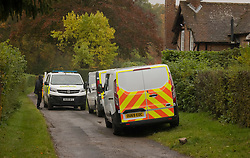 © Licensed to London News Pictures. 24/10/2020. Christmas Common, UK. Police vehicles surround a house at Christmas Common near Watlington Hill after the body of a woman was found on Friday 23rd October. An injured man was arrested by police nearby after a man was seen acting suspiciously in a pub. Photo credit: Peter Macdiarmid/LNP