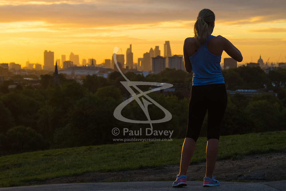 Primrose Hill, London, September 27th 2016. A runner takes a picture of the London skyline on Primrose Hill as dawn breaks over the capital. ©Paul Davey<br /> FOR LICENCING CONTACT: Paul Davey +44 (0) 7966 016 296 paul@pauldaveycreative.co.uk