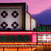 """The sunset shows behind the Maumee Indoor Theatre in Maumee, Ohio, on Friday, March 20, 2020. Although the theatre is not showing movies until further notice due to COVID-19, they are serving patrons  """"take out"""" popcorn 6 p.m. to 8 p.m. nightly. THE BLADE/KURT STEISS"""