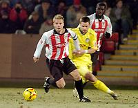 Photo: Leigh Quinnell.<br /> Cheltenham Town v Colchester United. LDV Vans Trophy.<br /> 24/01/2006. Cheltenhams captain John Finnigan is chased by Colchesters John White.