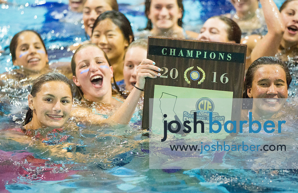 Santa Margarita celebrates after being awarded the girls team championship plaque during the CIF-SS Division 1 Swimming Finals at Riverside City College on Saturday.