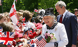 Britain's Queen Elizabeth II and US President George Bush walk to Blair House, Washington DC, on the sixth day of her state visit to America.