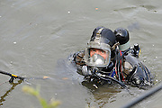 © licensed to London News Pictures. RICHMOND, UK.  01/08/11. A police diver searches the banks. The Metropolitan police search the River Thames near Richmond, London, today (1 Aug 2011) after a 17 year boy went missing after taking part in a kayak competition.  Mandatory Credit Stephen Simpson/LNP