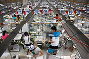 Close to a thousand employees, mostly women, work side by side on a production floor at a Textile Alliance Apparel factory in Qingxi Township, Dongguan, Guangdong Province, China, on July 28, 2010.  The factory supplies shirts and pants to major brands such as J Crew, Hugo Boss, Burberry, etc and produces over 300,000 shirts per day