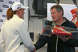 Slovenian cross-country skier Petra Majdic gets a gift from general manager of Alpina Ziri Matjaz Lenassi at Alpina presentation of new cross-country shoes with red dot award: product design, on April 24, 2008, in Pokljuka, Rudno polje, Slovenia.  (Photo by Vid Ponikvar / Sportal Images)/ Sportida)