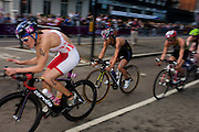 Line Jensen of Denmark (#19, left) leads Japan's Mariko Adachi (#15) in the cycling phase of the womens' Triathlon held in Hyde Park during the London 2012 Olympics. The race was eventually won in a photo finish by the Swiss Nicola Spirig, Lisa Norden (Silver) and Australia's Erin Densham (Bronze)