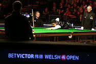 China's Ding Junhui on his way to completing a 147 break during his match against Neil Robertson of Australia. Betvictor Welsh Open snooker 2016, day 5 at the Motorpoint Arena in Cardiff, South Wales on Friday 19th Feb 2016.  <br /> pic by Andrew Orchard, Andrew Orchard sports photography.
