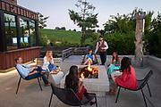 Wine Tasting around fire pit on patio overlooking Japanese Garden, Saffron Fields Vineyard, Yamhill-Carlton AVA, Willamette Valley, Oregon