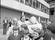 The return of Johnny Logan to Dublin Airport from Holland where he won the Eurovision Song Contest for Ireland with his entry What's Another Year..1980-04-21.21st April 1980.21-04-1980.04-21-80..Photographed at Dublin Airport..Shay Healy, composer of What's Another Day celebrates with the bubbly.