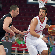 Turkey's Kerem TUNCERI (R) during their Istanbul CUP 2011match played Turkey between New Zeland at Abdi Ipekci Arena in Istanbul, Turkey on 24 August 2011. Photo by TURKPIX