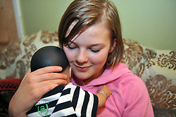 13 year old girl minds a 'real care baby' for the weekend as part of a school project to prevent teenage pregnancy.  The baby needs real care and is monitored by computer to check the progress and to make the situation realistic.MR