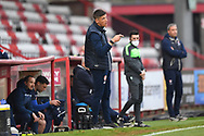 Stevenage Manager Alex Revell  pointing, directing, signalling, gesture in the technical area during the EFL Sky Bet League 2 match between Stevenage and Cheltenham Town at the Lamex Stadium, Stevenage, England on 20 April 2021.