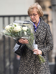 © Licensed to London News Pictures. 22/03/2018. London, UK. ANDREA LEADSOM MP leaves flowers on Parliament Square, outside the Houses of Parliament in Westminster, London on the one year anniversary of the the Westminster Bridge Terror attack. A lone terrorist killed 5 people and injured several more, in an attack using a car and a knife. The attacker, 52-year-old Briton Khalid Masood, managed to gain entry to the grounds of the Houses of Parliament and killed police officer Keith Palmer. Photo credit: Ben Cawthra/LNP