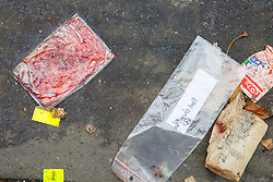 © Licensed to London News Pictures. 16/11/2015. Paris, France. Discarded of medical supplies left near Bataclan Cafe in Paris, France following the Paris terror attacks on Monday, 16 November 2015. Photo credit: Tolga Akmen/LNP