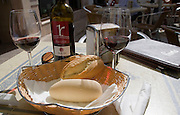 Wine and bread on restaurant table in Ronda, Spain