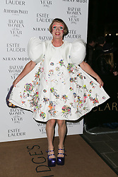 Grayson Perry arrives at Claridge's Hotel in London to attend the Harper's Bazaar Women of the Year Awards.