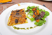 A tarte fine d oignon - think onion tart with salad with olives and anchovies. The restaurant Le Verger de Papes in Chateauneuf-du-Pape Vaucluse, Provence, France, Europe