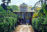 Old colonial style corrugated iron house in its garden, La Digue, Seychelles
