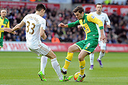 Swansea City's Federico Fernandez (l) and Norwich's Jonny Howson challenge for the ball. Barclays Premier league match, Swansea city v Norwich city at the Liberty Stadium in Swansea, South Wales on Saturday 5th March 2016.<br /> pic by  Carl Robertson, Andrew Orchard sports photography.