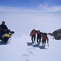 ANTARCTICA, Mike Graber & Rick Ridgeway film expedition team on summit of Rakekniven spire.