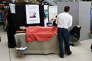 Demonstration of massage at alternative therapy day, Norwich, England
