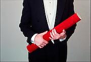 Nederland, Nijmegen, 27-10-2006..Promovendus houd de koker met de academische, wetenschappelijke bul in zijn handen...Foto: Flip Franssen/Hollandse Hoogte