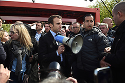 """Presidential election candidate for the En Marche ! movement Emmanuel Macron speaks to workers at the Whirlpool factory on April 26, 2017, in Amiens, north of France. Presidential frontrunner Emmanuel Macron was met on April 26, 2017 with boos and chants in favour of his far-right rival as he made a chaotic visit to an under-threat factory in northern France. During the hastily arranged visit, some in the crowd shouted """"President Marine!"""" and booed as the 39-year-old former banker stood outside the Whirlpool appliance factory in the rustbelt city of Amiens. Photo by Eliot Blondet/ABACAPRESS.COM"""