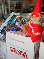 The Toys for Tots boxes filled with donated toys at Cantin's Chevrolet on Tuesday morning.  (Karen Bobotas/for the Laconia Daily Sun)