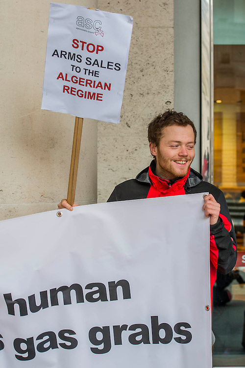 """Human rights protestors from the Algeria Solidarity Campaign (ASC) gather outside the London Stock Exchange to raise awareness about what they call 'the repressive Algerian regime' and its links with powerful multinationals such as BP who are keen on its gas reserves. Inside there is a business conference – The Algerian Investor Window – and the protestors hope to highlight issues about """"British collusion with a repressive and corrupt regime for the sake of business interests and securing fossil fuel supplies"""" with the attendees. Paternoster Square, London, UK 10 Feb 2014. Guy Bell, 07771 786236, guy@gbphotos.com"""