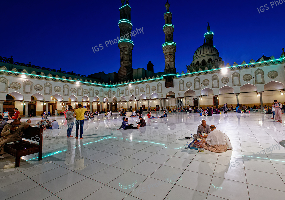 Moslems celebrating Iftar, at the end of a day of fasting during Ramadan, in the courtyard of the Al Azhar Mosque in Cairo