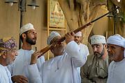 Oman, Nizwa souq gun sales at weekly goat auction