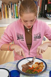 Girl eating a meal.
