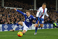 Gerard Deulofeu of Everton (l) and Dwight Gayle of Crystal Palace challenge for the ball. Barclays Premier league match, Everton v Crystal Palace at Goodison Park in Liverpool, Merseyside on Monday 7th December 2015.<br /> pic by Chris Stading, Andrew Orchard sports photography.