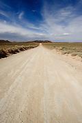 A desert road in southern Utah in the San Rafael Swell Area. Missoula Photographer