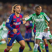 BARCELONA, SPAIN - August 25:  Antoine Griezmann #17 of Barcelona defended by Emerson #22 of Real Betis during the Barcelona V  Real Betis, La Liga regular season match at  Estadio Camp Nou on August 25th 2019 in Barcelona, Spain. (Photo by Tim Clayton/Corbis via Getty Images)