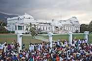People join in prayer next to the Presidential Palace in v damaged by the earthquake that devastated Haiti on January 12, 2010 killed over 200,000 people and left over a million people homeless.